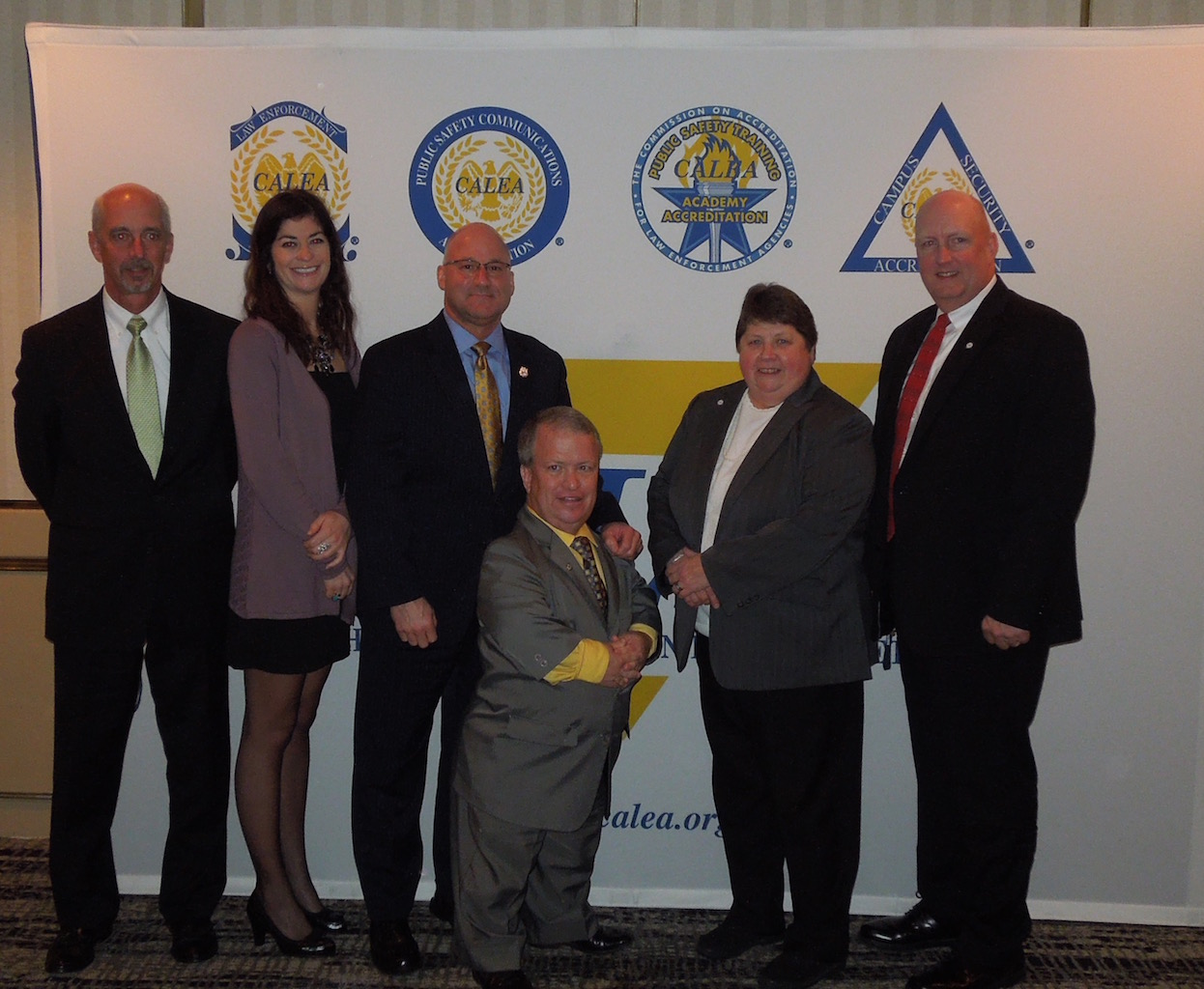 NNEPAC members Mike Raiche, Leanne Wancheck, Greg Murphy, Dennis Healy, Sue Lowrey, and Bill Wilmot pose for a photo after the celebration banquet at the Miami CALEA Conference held in November 2015.
