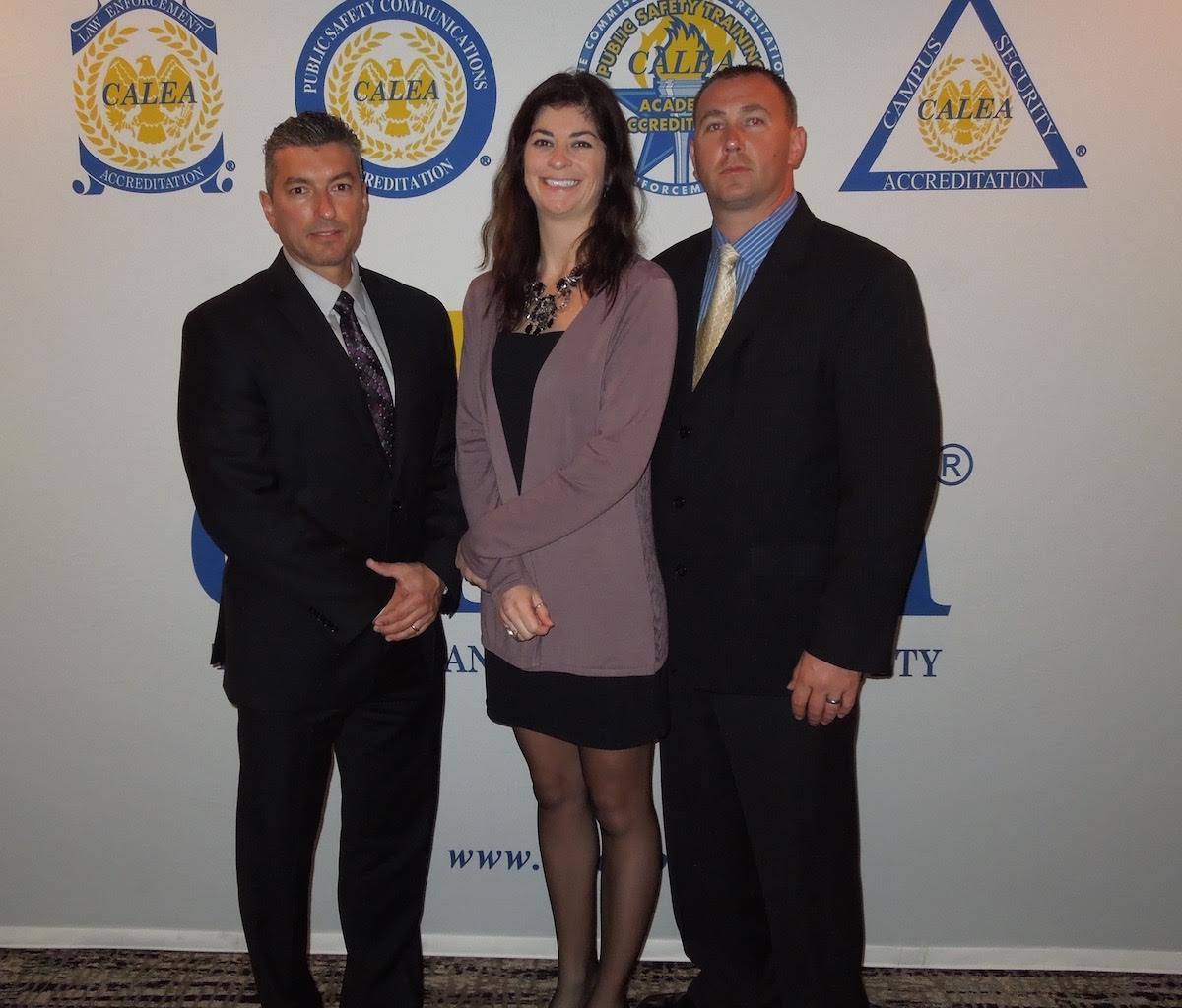 Newton, NH PD received their initial LE Accrdiation Award at the Miami CALEA Conferemce in November 2015. Shown in this photo after the banquet are Sgt. Rob DiFlumeri, Officer Leanne Wancheck (also the Accreditation Manager) and Sgt. Mike Jewett.