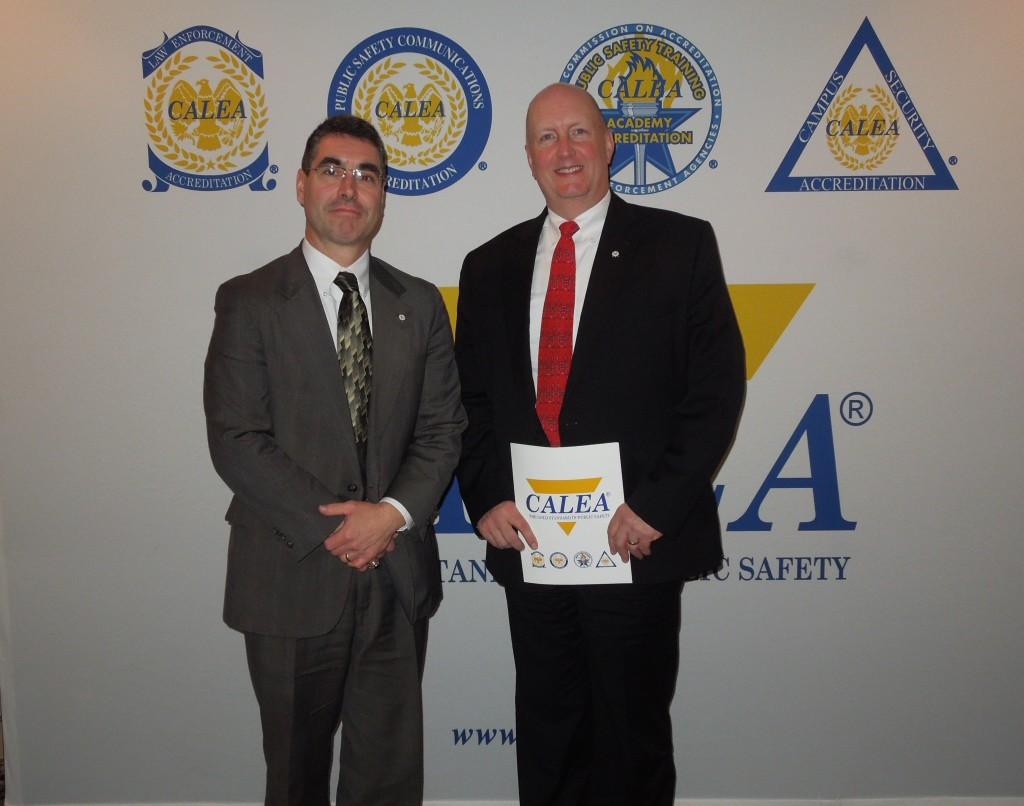 Claremont, NH Police Chief Alex Scott and NNEPAC Secretary and Claremont PD's Accreditation Manager Bill Wilmot pose for a photo after receiving their reaccreditation award at the Miamii CALEA conference.