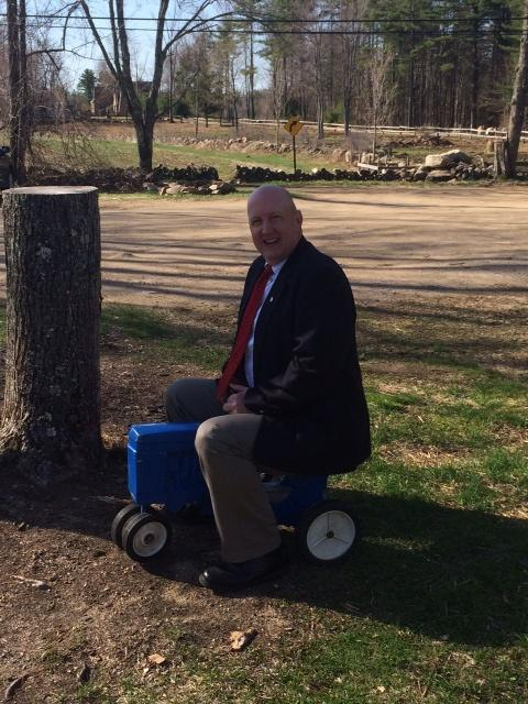 Bill Wilmot, NNEPAC Secretary and Claremont NH PD Accreditation Manager, takes a toy tractor for a spin during the 2014 NNEPAC Conference.