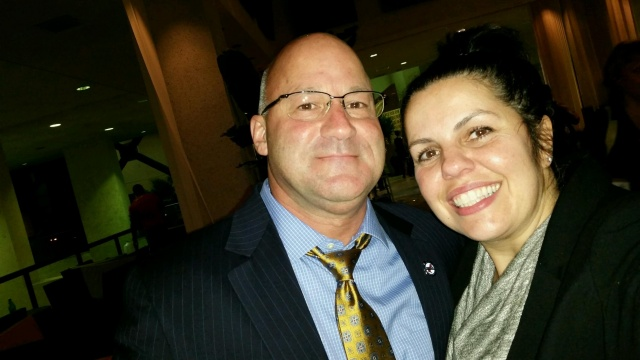 Greg Murphy and MBTA Transit Police AM Bobbi Spinosa pose for a selfie at the Miami CALEA Conference.